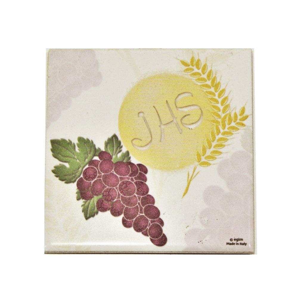 Piastra con uva calice e ostia